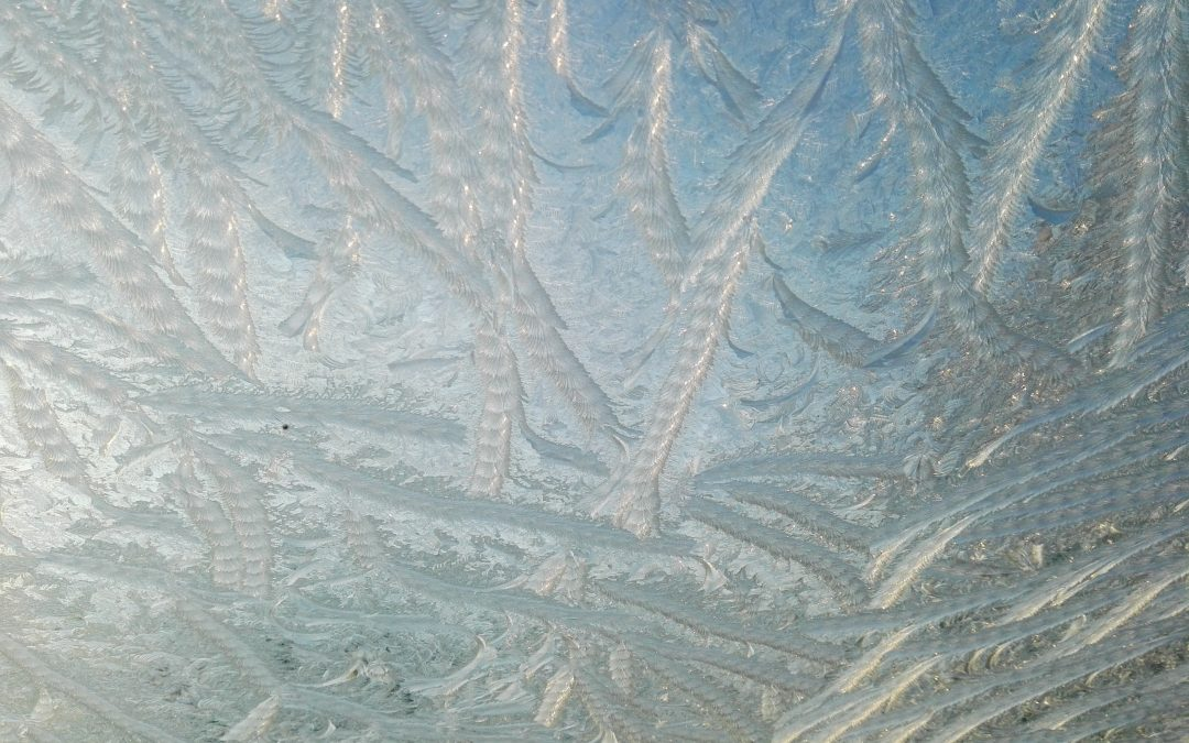 How do I clear ice from my windscreen?